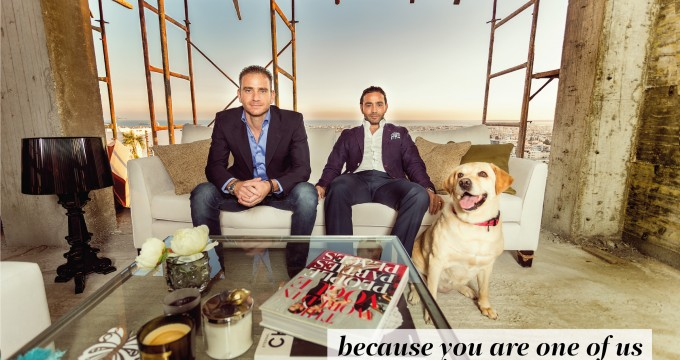imperio directors Antonis and Yiannis Misirlis and Carla the golden retriever, sitting on a sofa in a construction site