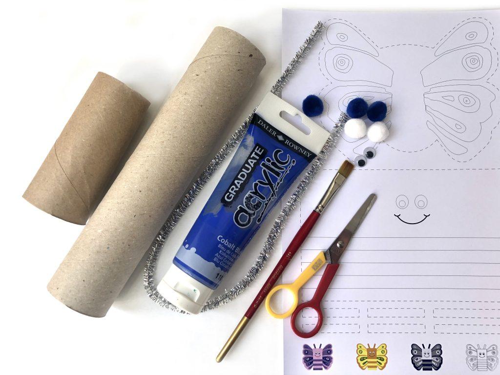 paper roll tube, paint, pom poms, scissors, brush, butterfly