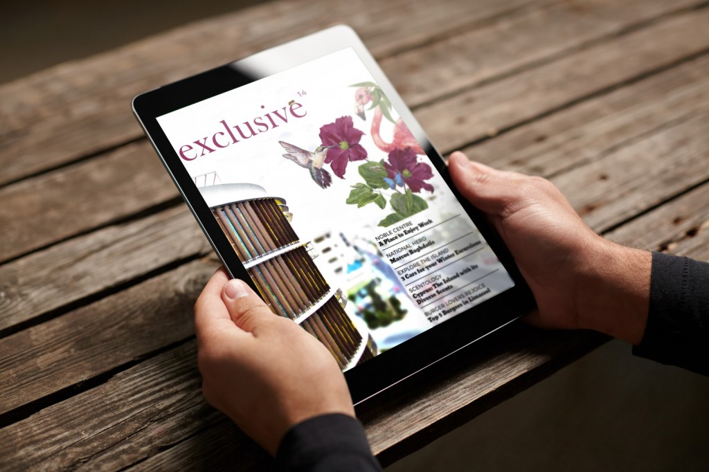 man holding ipad, reading exclusive magazine